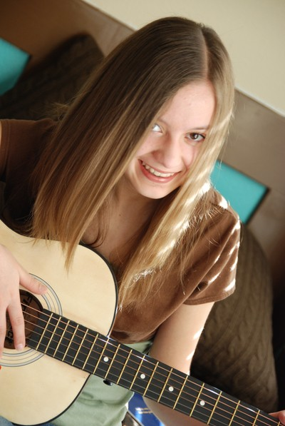 Andrea_playing_guitar
