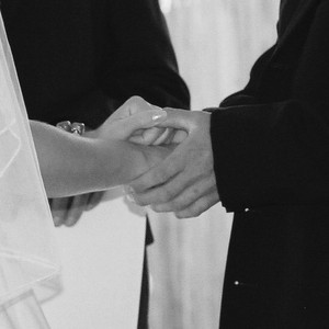Hands_during_ceremony_bw_square_2