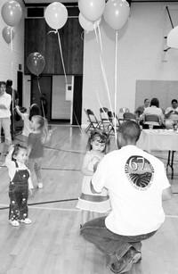 Robert_giving_balloons_to_kids