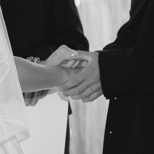 Hands_during_ceremony_bw_square